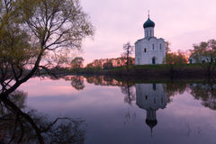 Church of the Intercession on the Nerl. River near Vladimir by a late spring sunrise. Historical monument of Russian ancient architecture. Famous landmark and Royalty Free Stock Image