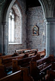 Church interior. Old church interior with light coming from a window Stock Photos