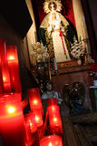 Church interior. In Barcelona, Spain, witg burning candles, angles and the virgin Mary Stock Images