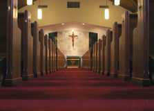 Church Interior. Interior landscape of church featuring center aisle, alter, cross and pews Stock Photography