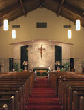 Church Interior. Interior landscape of church featuring center aisle, alter, cross and pews Stock Photos