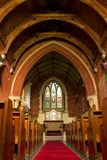Church interior. Portrait shot of church interior looking up aisle stock images