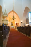 Church interior. With rows of benches and red carpet Royalty Free Stock Photography