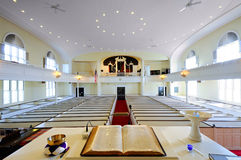 Church interior. From the pulpit. Open bible in foreground Royalty Free Stock Photography