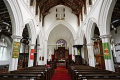 Bright village Church interior. Church interior of All Saints church Necton showing the east window communion table and clerestory. The church dates from the Stock Photography