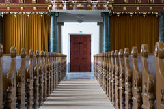 Church interior detail. Church interior, the ile with seats on both sides Royalty Free Stock Image