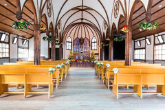 Church interior with empty wooden pews. Royalty Free Stock Photo
