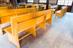 Church interior with empty wooden pews. Royalty Free Stock Photography