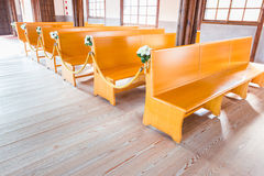 Church interior with empty wooden pews. Church interior with empty a row of wooden pews stock photo