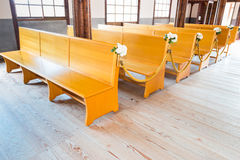 Church interior with empty wooden pews. Church interior with empty a row of wooden pews royalty free stock photos