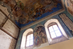 Church interior. Interior of an old russian christian orthodox church destroyed during the World War and now under reconstruction and repair. Old painting on the Stock Photo