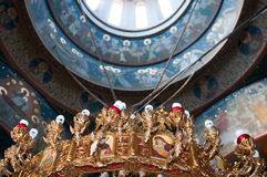 Church interior. With saints paints giant arches and an imposing chandelier Stock Photography