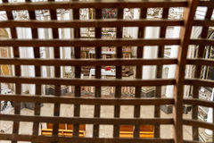 Church interior seen through wood grill Royalty Free Stock Images