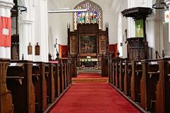 Church interior. Showing the pews,stain glass window communion table, jacobean pulpit and clerestory. The church dates back to the 14th century Royalty Free Stock Images