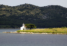 Church on island. A picturesque little church on a point of land on a little island near Pakostane, Croatia Royalty Free Stock Photo