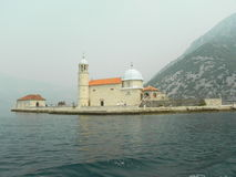 Church on the island  in the Bay of Kotor Stock Images