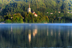 Church on the island - Lake bled in early morning Royalty Free Stock Images