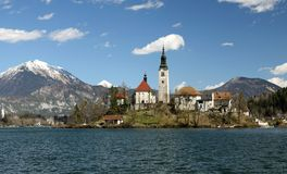 Church on the island of Lake BLED in SLOVENIA Europe and the mou. Church on the island of Lake BLED in SLOVENIA Europe and the snwy mountains in the background Royalty Free Stock Photography