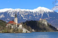 Church on the island of Lake BLED in SLOVENIA. Europe and the snowy mountains Stock Images