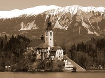 Church on the island of Lake BLED in SLOVENIA. Europe and the snowy mountains Stock Photos