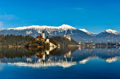 Church on Island in the Lake with Mountain Landscape Stock Image