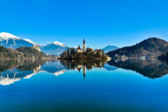 Church on Island in the Lake with Mountain Landscape Stock Photo
