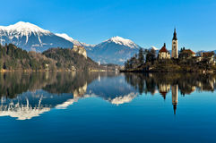 Church on Island in the Lake with Mountain Landscape Stock Photos