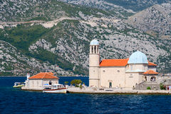 Church on the island of Virgin Mary on the reef (the island of O Royalty Free Stock Image