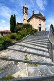 church    jerago  old   closed brick tower sidewalk italy Royalty Free Stock Photography