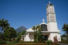 Church in La Fortuna. Church on main square of La Fortuna village, Costa Rica, with Arenal Volcano in background Royalty Free Stock Photo