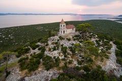 Church Lady of Loreto, on Pasman island, at dusk, Croatia Stock Photography