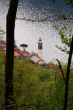 Church on the lake. Church of a little village called Nesso on the Como Lake in Italy, view from the surrounding woods Stock Photos