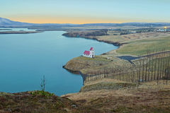 Church at a lake in the countryside from Iceland at sunrise Stock Images