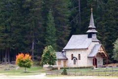 Church on lake Lago di Braies in Dolomiti Mountains Stock Photo