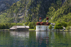 Church on a lake. Picture of St.Bartholoma on the Koenigssee Royalty Free Stock Images