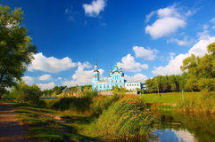 Church, lake and poplar park. Rushy lake with bridge in a white poplar park, next to the St. Nikolai's Cathedral. Komsomolsk, Poltavska region, Ukraine Royalty Free Stock Photography