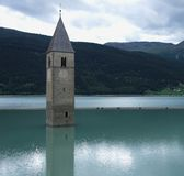 Church in a lake at Reschenpass Royalty Free Stock Images