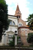 Church, lamppost, trees and palm tree in Vicenza in Veneto (Italy) Stock Photos