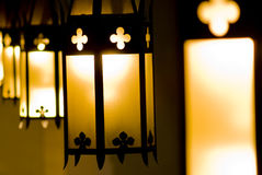 Church lamps in a perspective. Row lit during mass Royalty Free Stock Images