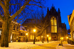 Church lane winter. Hooglandsekerkgracht looking at the back of the Hooglandse church in Leiden at twilight in winter with snow in the Netherlands Stock Image