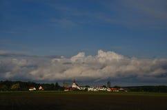 Church and large rain clouds Stock Photos