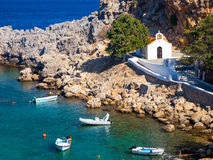 Church at Lindos Rhodes Greece. Tiny church and boats at St Pauls Bay Lindos Rhodes Greece Europe Stock Images