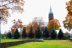 Church in little town at autumn time Royalty Free Stock Image