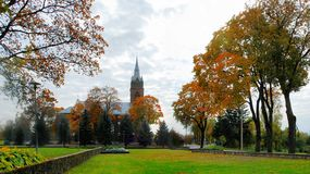 Church in little town at autumn time Stock Photo