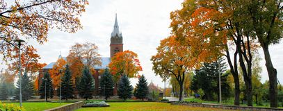 Church in little town at autumn time Stock Images