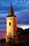 Church in a little village in evening light. stock photo