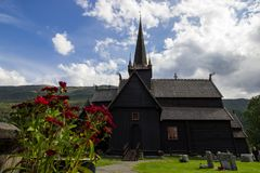 Church in Lom in Norway. Stavkirke church and gate in Lom in South Norway Stock Photography