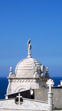 Church looking over ocean in luarca Spain Stock Photography