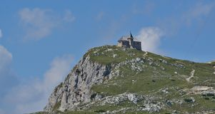 The church of Maria am Stein, the mountain Dobratsch, Austria royalty free stock images