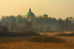Church among meadows in the winter morning. Royalty Free Stock Image